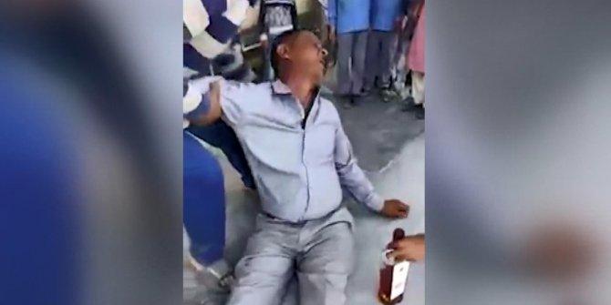 Sarhoş öğretmen sızdı, öğrenciler yanında poz verdi