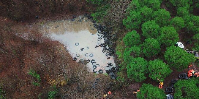 (Havadan fotoğraflarla) Şile'de ormanlık alana bırakılan lastikler kaldırılıyor