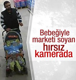 Bebeğini kullanarak marketi soyan hırsız kamerada