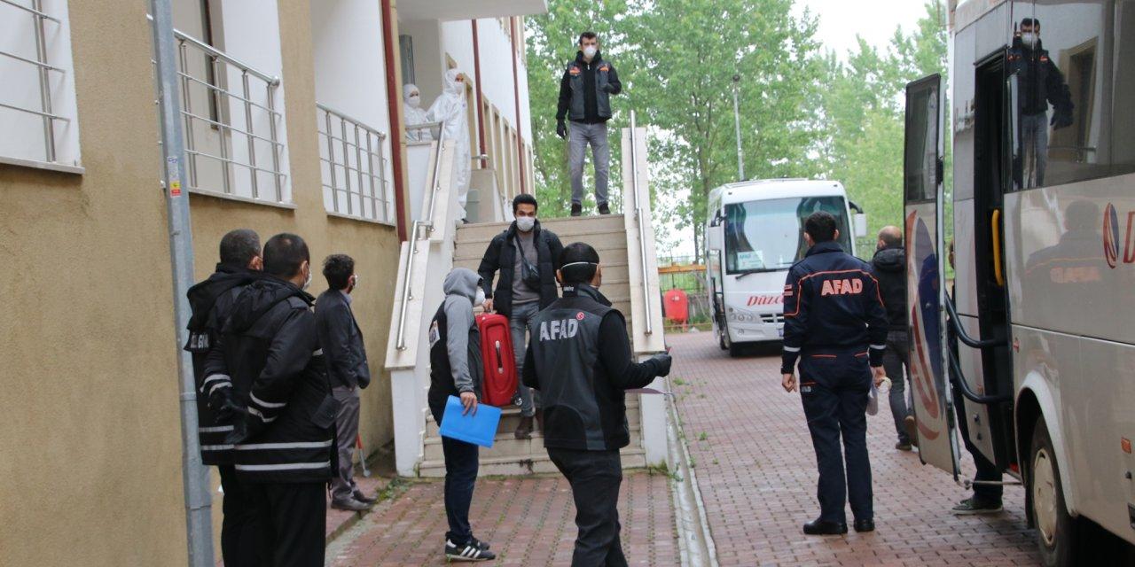 Romanya dönüşü Düzce'de karantinaya alınan 74 kişi, memleketlerine uğurlandı