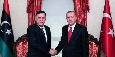 Libya Zirvesi'ne katılan Cumhurbaşkanı Erdoğan, Fayiz es-Serrac ile görüştü