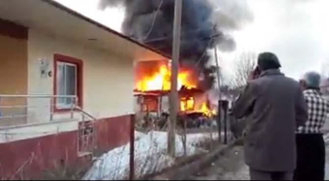 Yanan evde patlama meydana geldi
