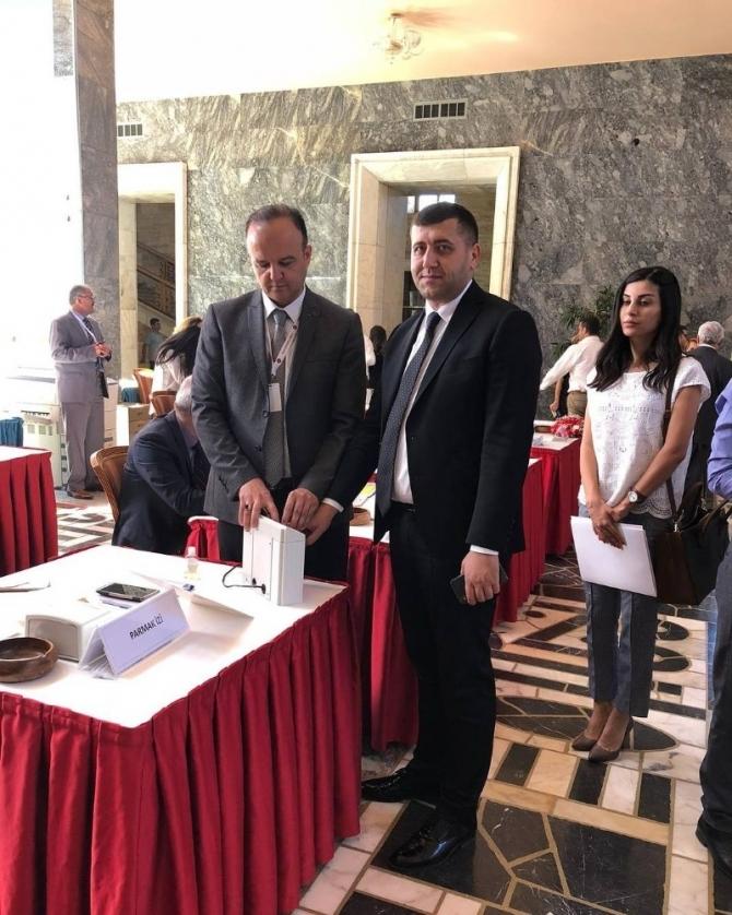 Baki Ersoy'un rozetini MHP İl Başkanı Serkan Tok Taktı