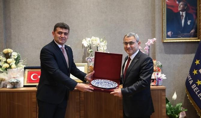 Aslanapa Belediye Başkanı ve Meclis Üyeleri'nden Alim Işık'a hayırlı olsun ziyareti