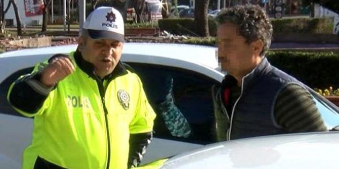 Emniyet kemeri takmadığı için ceza yiyen kişi polise hakaret etti!