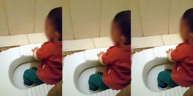 Ayağı tuvalete sıkışan çocuğun hali görenleri hayrete düşürdü!